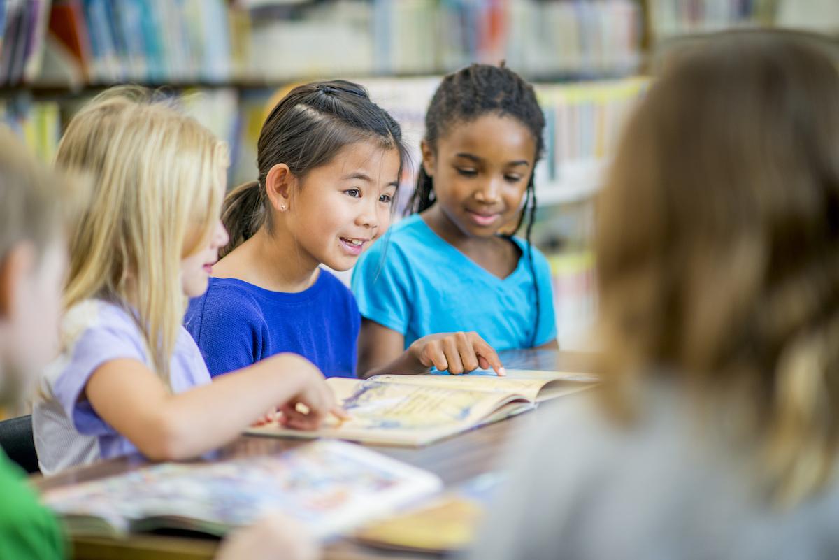 Preschoolers Reading Aloud In A Group
