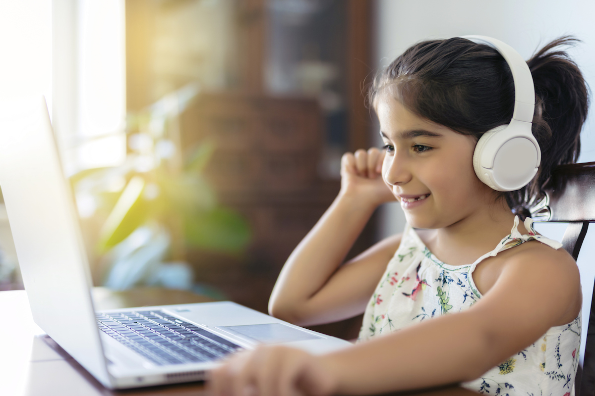 Young female student learns online while building a solid foundation through social and emotional learning